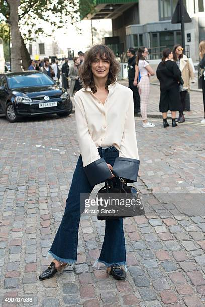 Fashion Blogger Irina Lakicevic wears a JW Anderson shirt Louis Vuitton bag MarquesAlmeida jeans and Gucci shoes on day 3 during London Fashion Week...