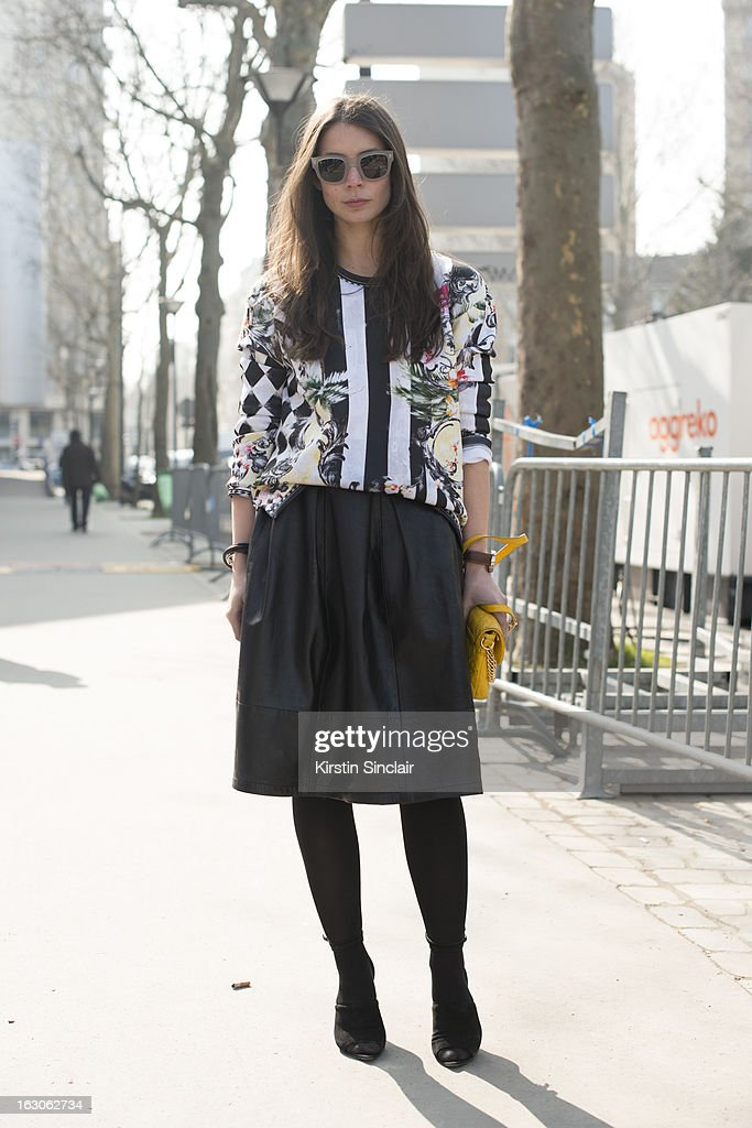 Fashion blogger Irina Lakicevic wears Alexander Wang Shoes, Top Shop skirt, Acne glasses, Marc Jacobs bag and a Balmain shirt on day 4 of Paris Womens Fashion Week Autumn/Winter 2013 on March 03, 2013 in Paris, France.