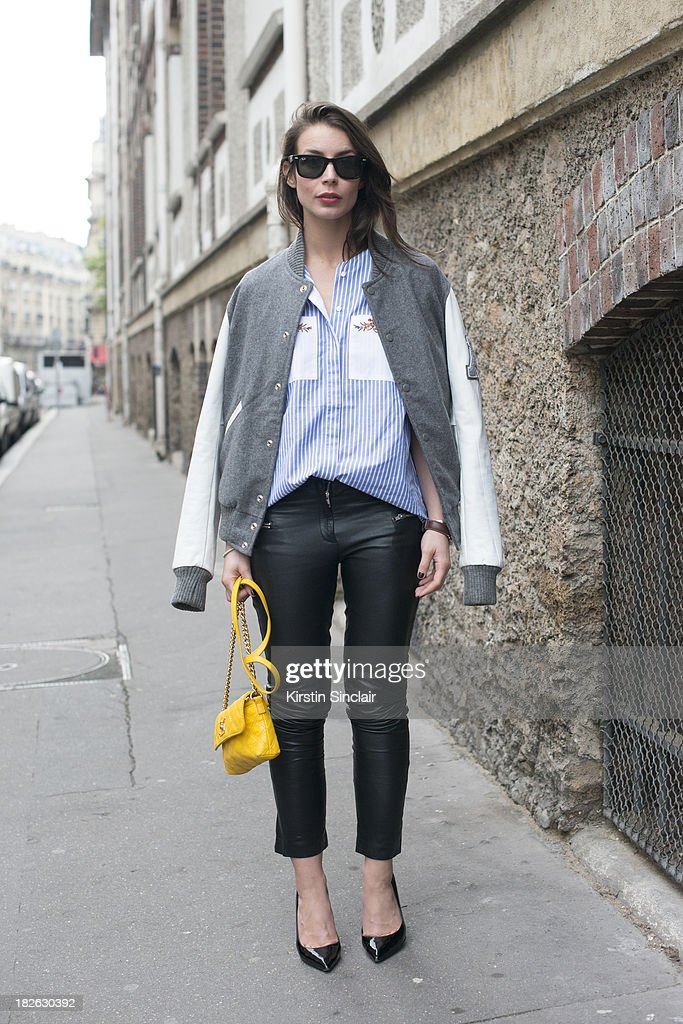 Fashion blogger Irina Lakicevic wears American College jacket, Ray Ban sunglasses, Marc Jacobs bag, Suno shirt, Malene Birger trousers and Saint Laurent shoes on day 6 of Paris Fashion Week Spring/Summer 2014, Paris September 29, 2013 in Paris, France.