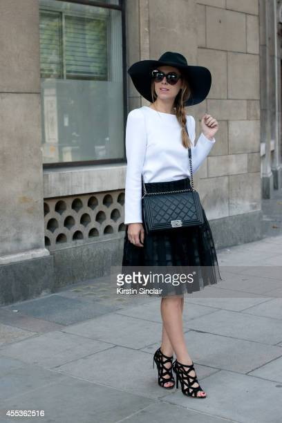 Fashion Blogger Jenny Bernheim is wearing a Chanel bag Sachin and Babi skirt Line and dot top Sophia Webster shoes BCBG hat and Karen Walker...