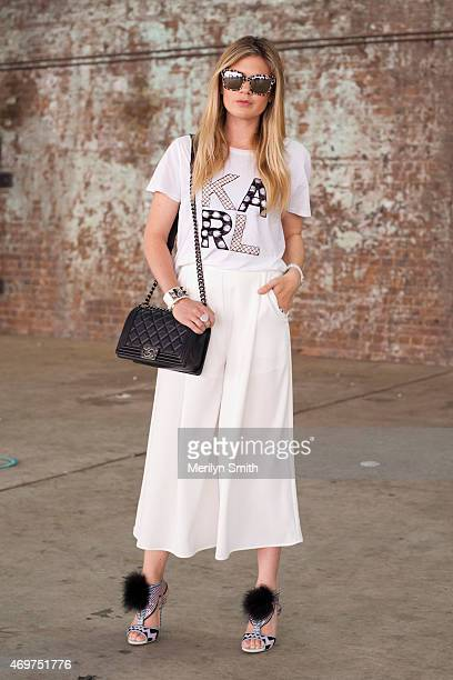 Fashion Blogger Jess Dempsey wears a Karl Lagerfeld shirtThe Fifth trousers Chanel bag and Dolce and Gabbana sunglasses at MercedesBenz Fashion Week...