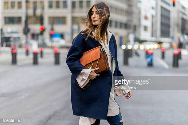 Fashion blogger Julia Haghjoo wearing COS blouse coat Max Co Zara pants Chloe bag during the MercedesBenz Fashion Week Berlin Autumn/Winter 2016 at...