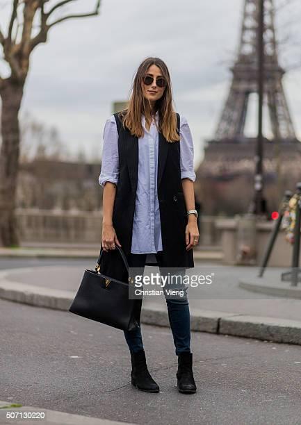 Fashion blogger Julia Haghjoo wearing Gestuz vest MIH blouse Zara pants Louis Vuitton bag Ray Ban sunglasses Zalando boots during the Paris Fashion...