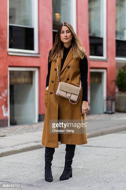 Fashion blogger Julia Haghjoo wearing Sam Edelman boots Chloe bag J Brand jeans vest and top Zara during the Copenhagen Fashion Week Autumn/Winter...