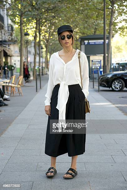 Fashion Blogger Julia Haghjoo wears a Gauchere Paris hat Asos top Tibi trousers Birkenstock shoes Jimmy Choo bag and Rayban sunglasses on day 5...