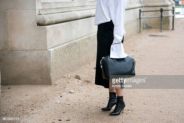 Fashion Blogger Kaitlyn Ham wears a Givenchy bag Gianvito Rossi boots Ellery skirt and Anna Quan shirt on day 8 during Paris Fashion Week...