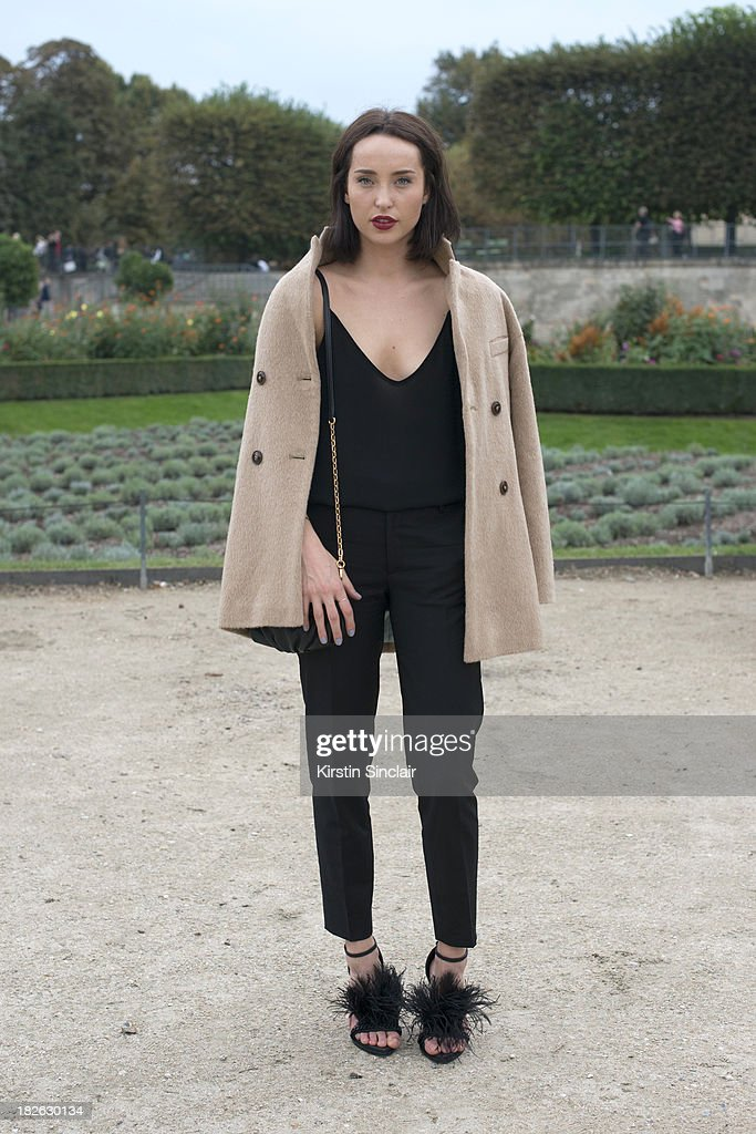 Fashion blogger Karen Kjerstad wears a Fillipa K jacket and trousers, Givenchy shoes, Zara top and Marc by Marc Jacobs bag on day 7 of Paris Fashion Week Spring/Summer 2014, Paris September 30, 2013 in Paris, France.