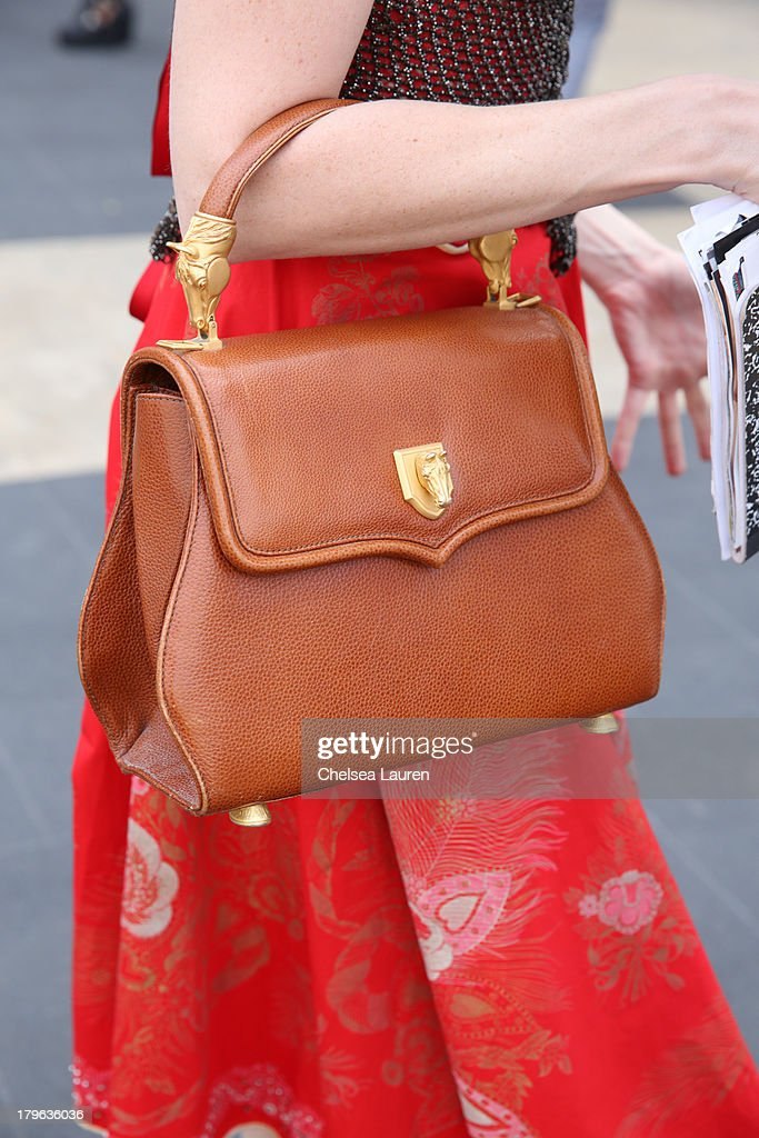 Fashion blogger Karen Weaver aka Ginger (purse detail) is seen wearing a vintage outfit on the Streets of Manhattan on September 5, 2013 in New York City.