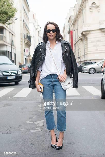 Fashion blogger Karn Kjerstad wears BLK DNM jacket Fillipa K shirt Acne jeans Zara shoes Ray Ban sunglasses and Lu Lu's bag on day 6 of Paris Fashion...