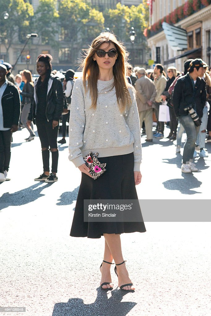Fashion Blogger Kristi Gogsadze wears Aldo shoes Mo and Co sweater Karl Lagerfeld clutch Taylor and Morris sunglasses on day 3 during Paris Fashion...