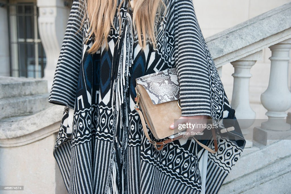 Fashion blogger Kristina Bazan wears a Chloe cape dress and bag at the Chloe show on day 6 of Paris Collections Women on March 08 2015 in Paris France