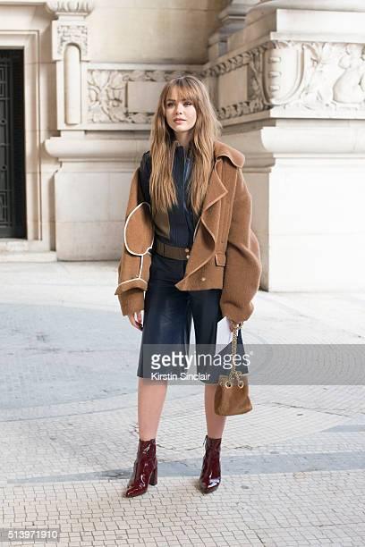 Fashion blogger Kristina Bazan wears a Diane Von Furstenberg jumpsuit and Rochas shoes on day 2 during Paris Fashion Week Autumn/Winter 2016/17 on...