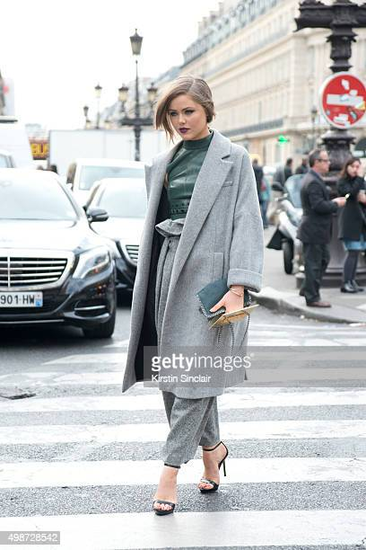 Fashion Blogger Kristina Bazan wears a Stella McCartney jacket trousers and bag with a Thierry Mugler top on day 7 during Paris Fashion Week...