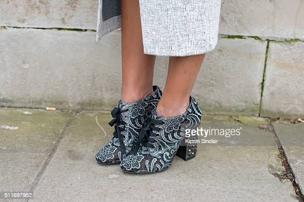 Fashion blogger Lala Noleto wears a Carina Dueck coat and Dolce and Gabbana shoes on day 3 during London Fashion Week Autumn/Winter 2016/17 on...