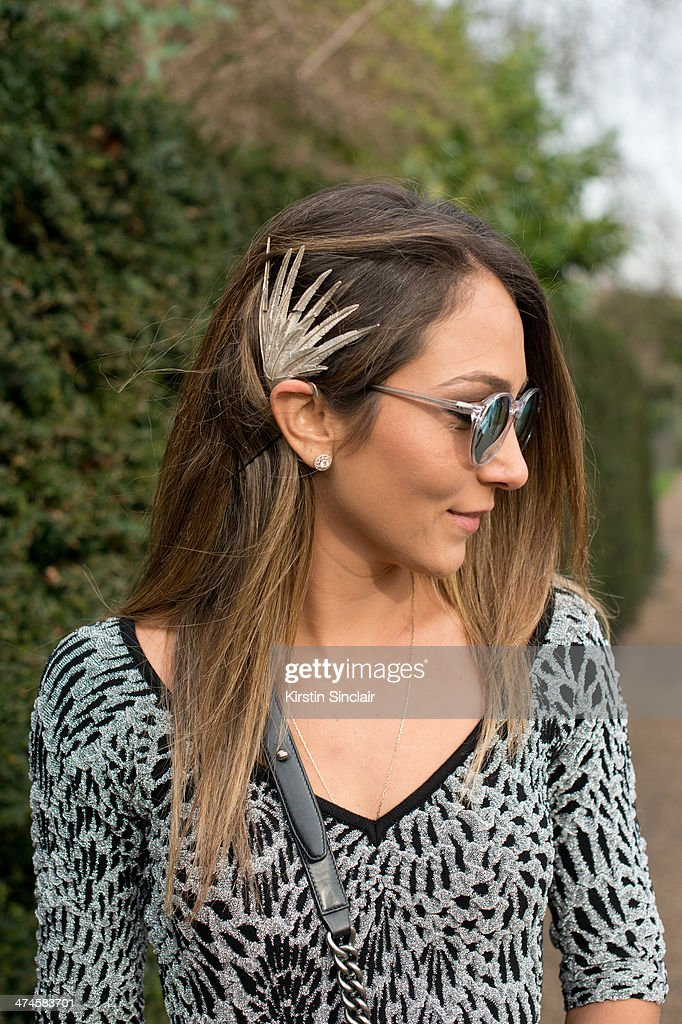Fashion Blogger Lala Noleto wears a Gig dress, Ventura sunglasses, Ucha Valverde and Juliana Manzini jewellery on day 4 of London Collections: Women on February 17, 2014 in London, England.