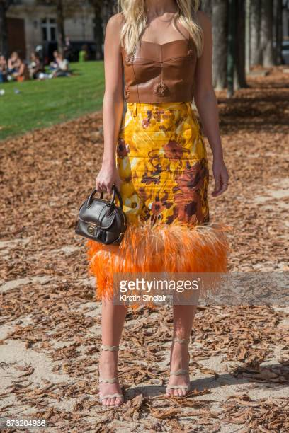 Fashion blogger Lala Rudge wears a Valentino top Prada skirt and shoes and Salvatore Ferragamo bag day 4 of Paris Womens Fashion Week Spring/Summer...