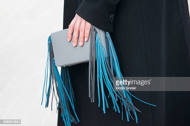 Fashion blogger Laura Comolli wears a Lina Brax bag on day 9 of Paris Collections Women on March 11 2015 in Paris France