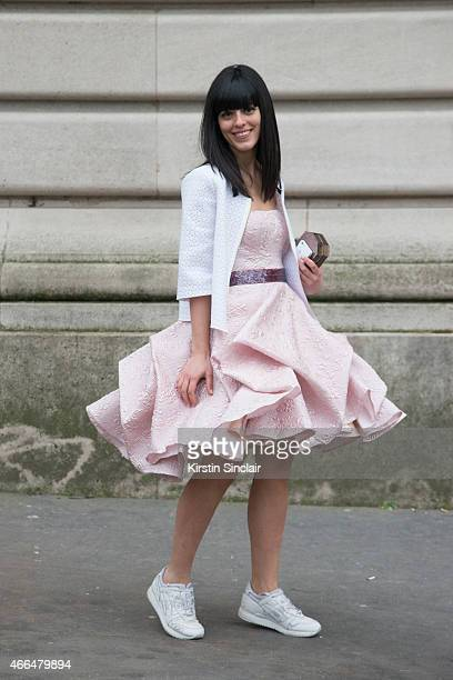 Fashion blogger Laura Comolli wears a Peter Langner dress Asics shoes and a Lolita Lorenzo bag on day 7 of Paris Collections Women on March 09 2015...