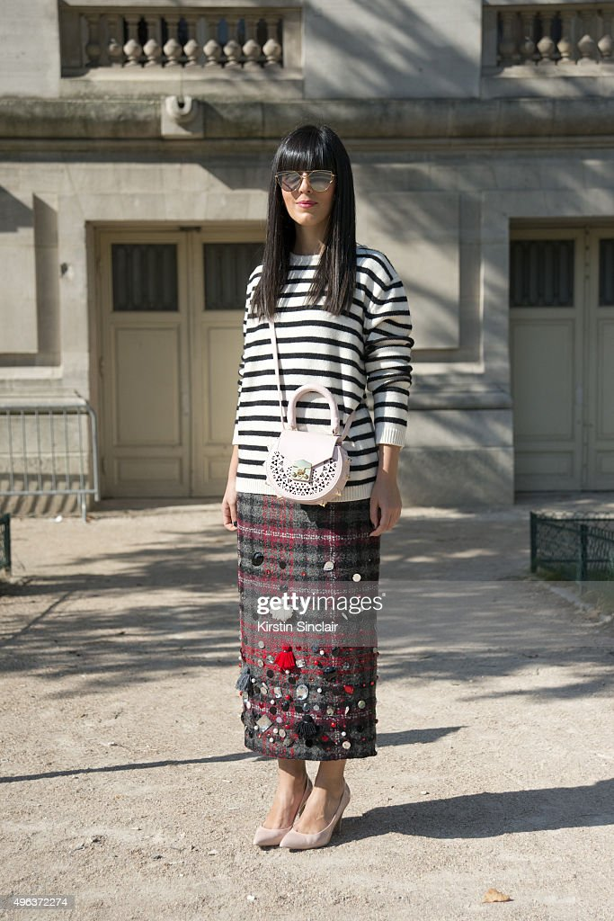 Fashion Blogger Laura Comolli wears a Stella Jean top and skirt Salara bag and Gentle Monster sunglasses on day 5 during Paris Fashion Week...
