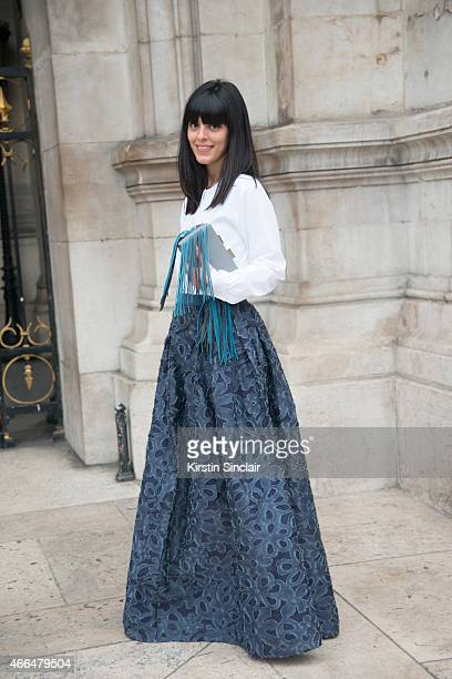 Fashion blogger Laura Comolli wears Jiljil skirt vintage shirt and Lina Brox bag on day 7 of Paris Collections Women on March 09 2015 in Paris France