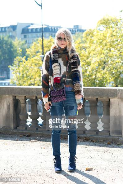 Fashion Blogger Laura Tonda wears a Monki sweater Missoni bag 5th Preview jeans Toga shoes and Dolce Gabbana sunglasses on day 3 during Paris Fashion...