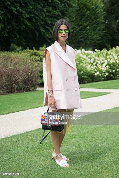 Fashion blogger Leandra Medine wearing a Dior jacket Ray Ban sunglasses and a Paula Cademartori bag day 2 of Paris Haute Couture Fashion Week...