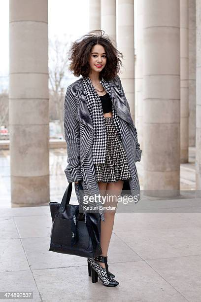 Fashion Blogger Lena Mahfouf wears a Front Row skirt Marc Jacobs bag Forever 21 shoes vintage coat and jacket on day 1 of Paris Collections Women on...