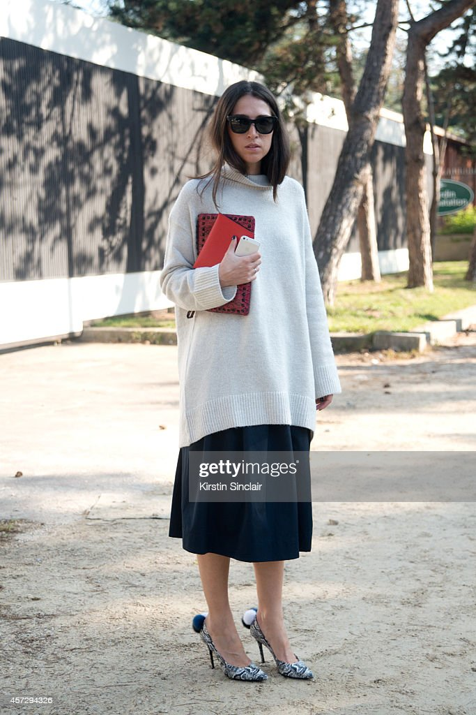 Fashion Blogger Lia Makrigeni is wearing Aperlai shoes Valentino bag Zara top and skirt and Prada sunglasses on day 9 of Paris Collections Women on...