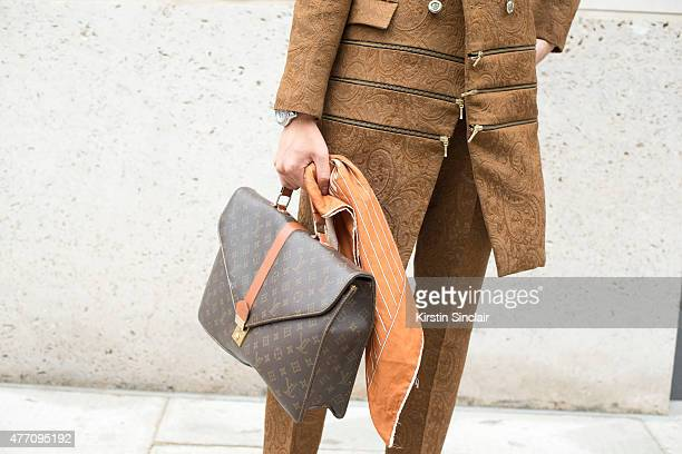 Fashion blogger Lifestyle Photographer Toni Tran wears Louis Vuitton bag vintage scarf bespoke Fashitects suit on day 2 of London Collections Men on...