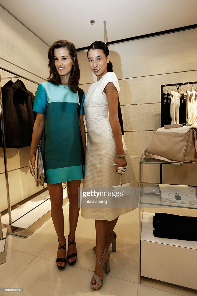 Fashion Blogger Lily Kwong (L) and Fashion Blogger Hanneli Mustaparta pose for picture during the Fall 2012 Presentation at ck Calvin Klein store in Oriental Plaza on November 13, 2012 in Beijing, China.