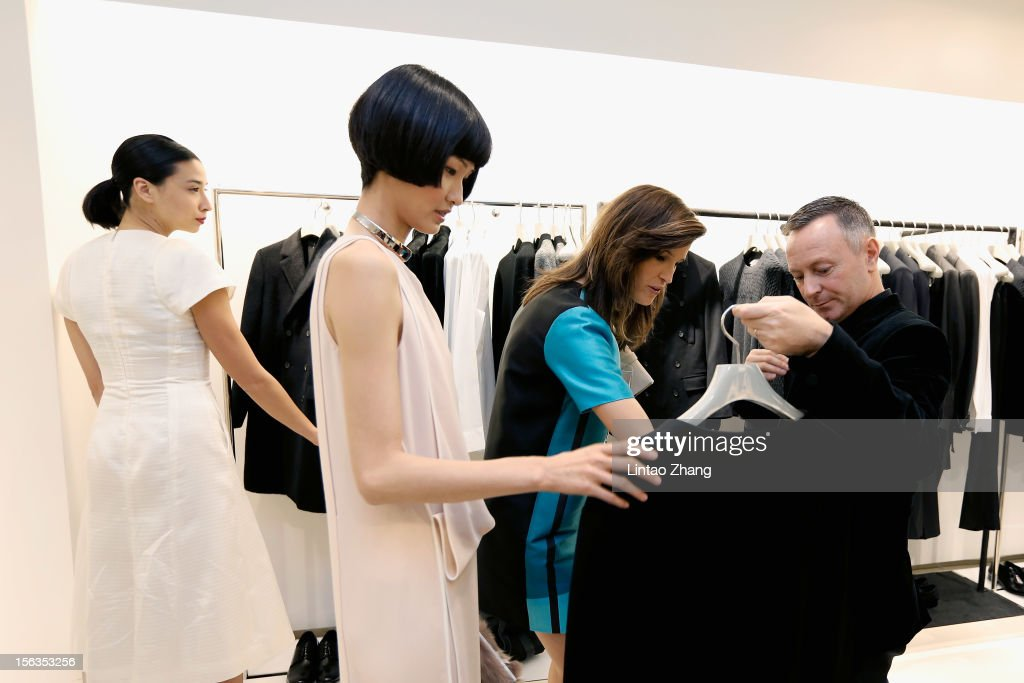 Fashion Blogger Lily Kwong, Model Wang Xiao, Fashion Blogger Hanneli Mustaparta and Kevin Carrigan, CK Global Creative Director, chat during the Fall 2012 Presentation at ck Calvin Klein store in Oriental Plaza on November 13, 2012 in Beijing, China.