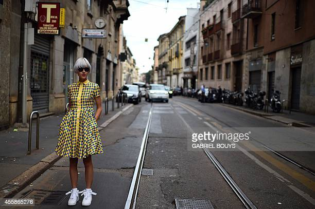 Fashion blogger Linda Tol poses in the street prior a show during the 2015 Spring / Summer Milan Fashion Week on September 21 2014 in Milan AFP PHOTO...