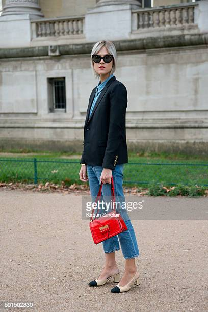 Fashion Blogger Linda Tol wears Chanel shoes Saint Laurent jacket Calvin Klein shirt Acne jeans Fendi sunglasses and a Loewe bag on day 8 during...