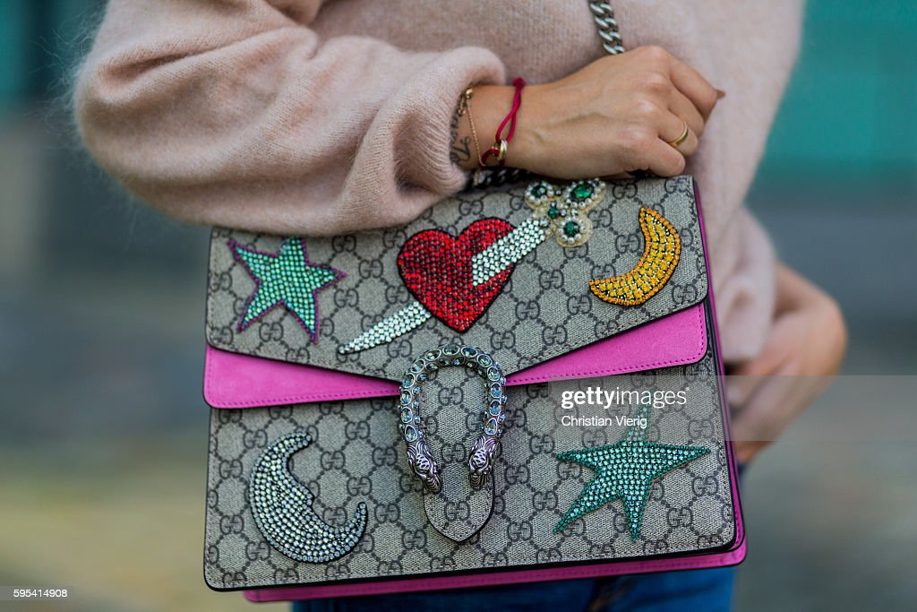 Fashion blogger Lisa Hahnbueck wearing a salmon pink Acne Merino Knit Gucci Dionysus bag on August 25 2016 in Duesseldorf Germany