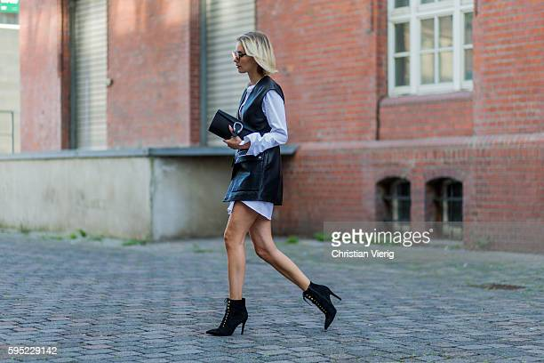 Fashion blogger Lisa Hahnbueck wearing black Set leather vest white Cos Maxi Sleeve black Mai Più Senza ankle boots black Gucci Dionysus Clutch on...