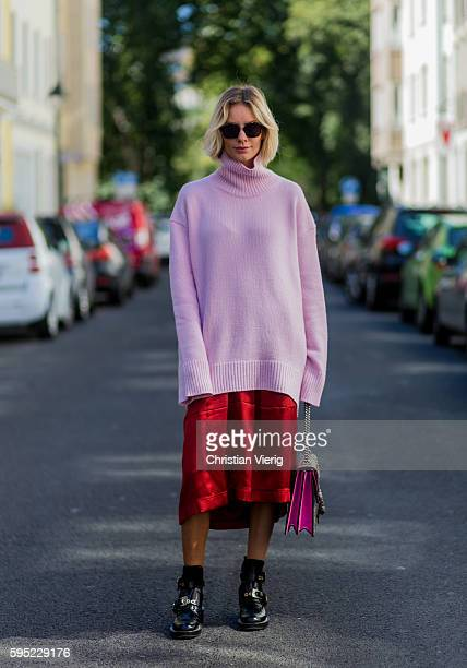 Fashion blogger Lisa Hahnbueck wearing Dior Abstract sunglasses a pink Celine Cashmere Turtle Neck red Celine Silk Pants black Balenciaga Boots Gucci...
