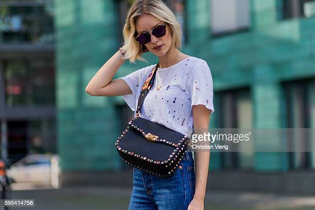 Fashion blogger Lisa Hahnbueck wearing Dior Abstract sunglasses blue denim Levis´s Wedgie Jeans white Iro TShirt black Valentino Guitar Rockstud...