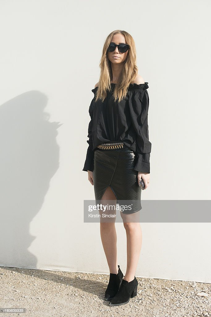Fashion blogger Lisa Olsson wearing a Nellie.com skirt and top with Zara shoes and belt on day 9 of Paris Fashion Week Spring/Summer 2014, Paris October 02, 2013 in Paris, France.
