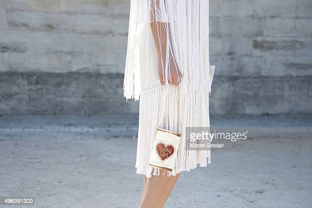 Fashion Blogger Lise Grendene wears a Charlotte Olympia bag and a vintage dress on day 5 during Paris Fashion Week Spring/Summer 2016/17 on October 3...