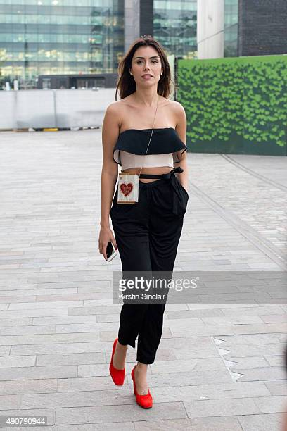 Fashion Blogger Lise Grendene wears a Issa top and trousers Celine shoes and Charlotte Olympia bag on day 3 during London Fashion Week Spring/Summer...