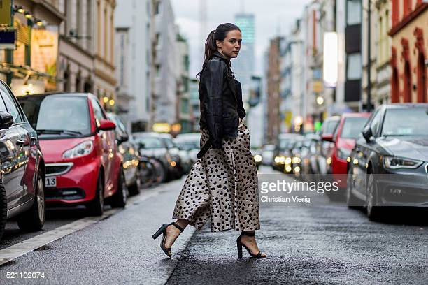Fashion blogger Lou Beyer wearing a black Tigha leather jacket a black super girl sweater from Articus Mini leopard printed culottes from c meo...