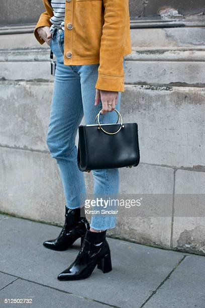 Fashion blogger Lucy Williams wears all Topshop and a Future Glory bag on day 3 during London Fashion Week Autumn/Winter 2016/17 on February 21 2016...