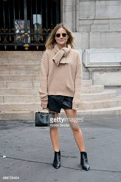 Fashion Blogger Lucy Williams wears an Asos skirt JW Anderson sweater Acne boots Future Glory bag and Ray ban sunglasses on day 7 during Paris...