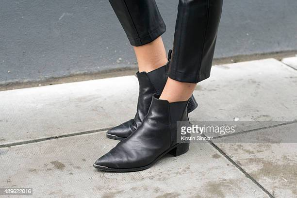 Fashion blogger Lucy Williams wears Armani Exchange trousers and Acne boots on day 5 during London Fashion Week Spring/Summer 2016/17 on September 22...