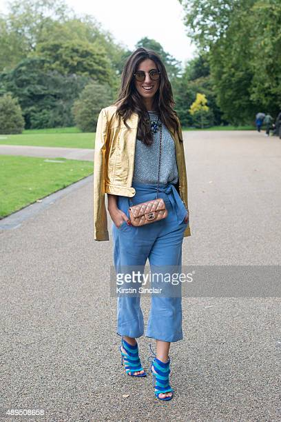 Fashion blogger Luiza Sobral wears Pat Pat jacket Chanel bag Alberto Moretti shoes Bauhaus trousers and Kyme sunglasses on day 4 during London...