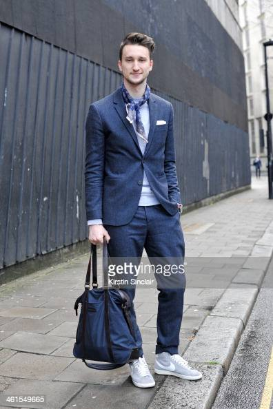 Fashion blogger Marcel Fluruss wears a Men in Cities tie Nike trainers Armarni Exchange bag Cos suit and a Handvaerk jumper day 2 of London Mens...