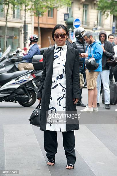 Fashion blogger Margaret Zhang wears an Acler dress Josh Goot pants and Givenchy bag on day 4 of Paris Fashion Week Haute Couture Autumn/Winter 2015...