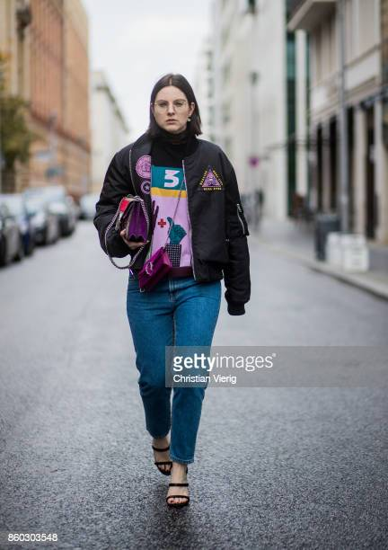 Fashion blogger Maria Barteczko wearing an embroidered black bomber jacket with patches Givenchy colorful turtle neck knitwear Valentino high waisted...