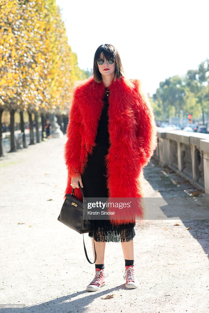Fashion Blogger Marianne Theodorson wears a Sackspot jacket Rayban sunglasses Converse shoes Hermes bag and H and M dress on day 3 during Paris...