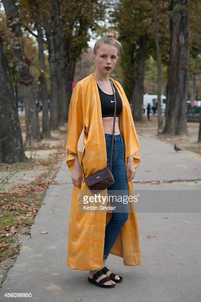 Fashion Blogger Marie Jenson is wearing Vagabond shoes Weekday jeans Nike top and vintage kimono on day 2 of Paris Collections Women on September 24...